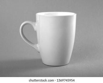 Empty white mug on a gray background