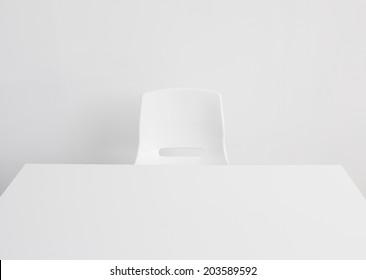 Empty white office desk