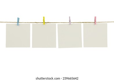 empty white photo frames hanging with clothespins isolated on white background