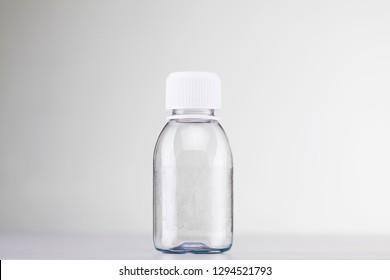 empty white plastic bottle with white cap