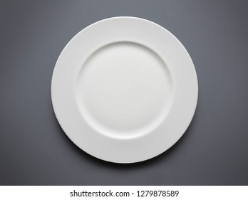 empty white plate from above on grey background