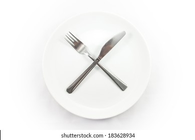 Empty white plate with the knife and fork on white background