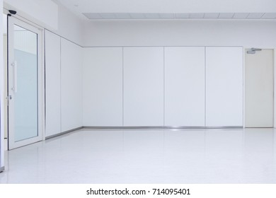 Empty white room with ceiling floor and door, nobody space interior. no furniture.