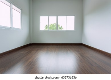 empty white room interior design with window sliding and wood laminate floor