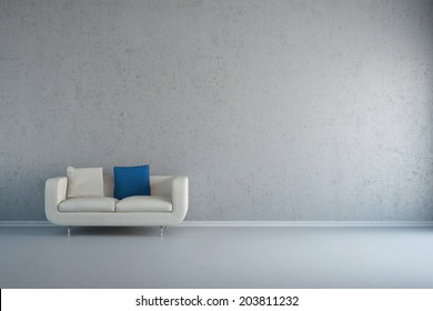 Empty white room with leather loveseat and concrete wall
