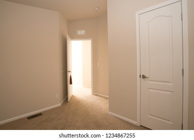 An empty white room showing space, design, and potential.