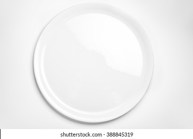 Empty white round plate isolated on white background. Pizza or salad plate empty.