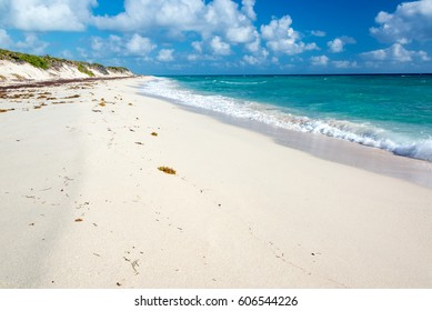 Empty white sandy beach in the Sian Kaan Biosphere Reserve near Tulum, Mexico