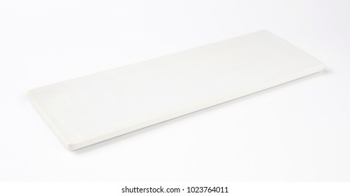 empty white serving plate isolated over white background