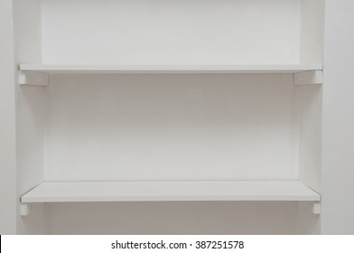 Empty white shelves ideal for placing an object