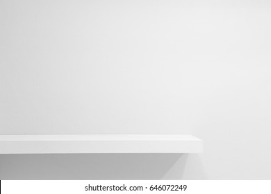 Empty white shop shelf, retail shelf on white vintage background.