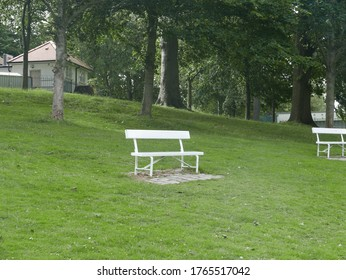 Empty white stainless steel bench in the Phoenix Park