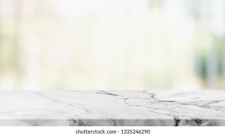Empty white stone marble table top and blurred abstract background from shopping mall background - can used for display or montage your products.