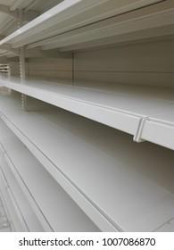 empty white store shelves