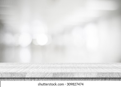Empty white table and blurred abstract background with bokeh light, product display template, black and white tone