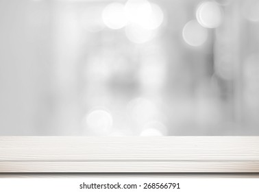 Empty white table and blurred store bokeh background, product display montage