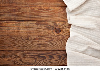 Empty white tablecloth on wooden desk