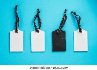 Empty white tags in a row on blue background. Top view. Mock up sample. Blank price tag. Design for shopping label template, discount, Sale. Sales tags.