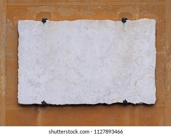 Empty white vintage marble stone plate on grunge wall