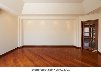 Empty white wall with 4 spot lights and wooden floor