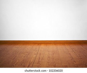 Empty white wall and wooden floor