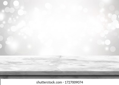 Empty white-Gray marble table  top on white bokeh abstract background . For placing products. information for marketing announcements  concepts