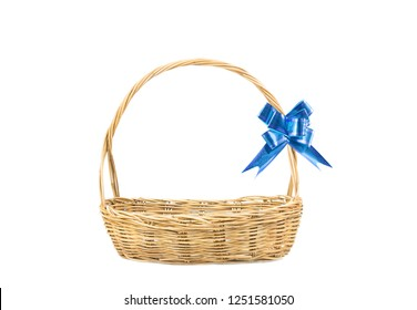 Empty wicker basket with blue ribbon isolated on white background