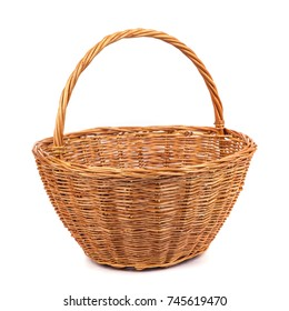 Empty wicker basket for fruits and vegetables, isolated on white.
