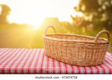 Empty wicker basket on the table with a background in natural morning ,Template mock up for display of product