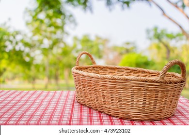 Empty wicker basket on the table with the natural background,Template mock up for display of product