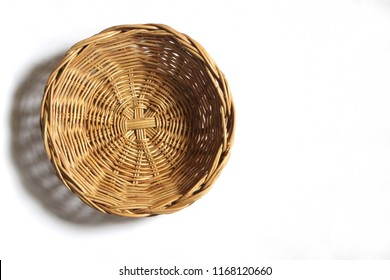 Empty Wicker basket on white background. Top view.