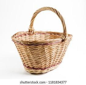 empty wicker basket on a white background