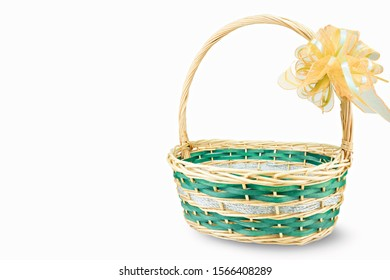 Empty wicker basket with ribbon isolated on white background