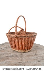 Empty wicker baskets on a white background