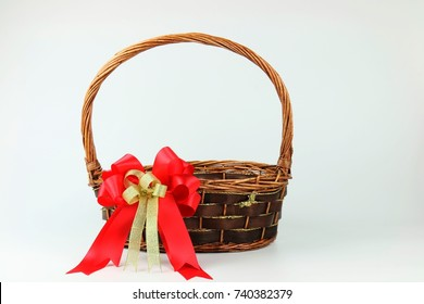 Empty wicker with red-gold ribbon flower bow Decorating on white copy space background for Christmas and new year gift basket event