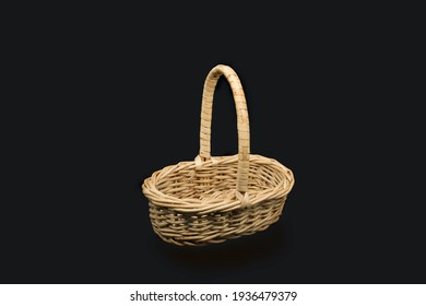 Empty wicker wooden basket on isolated black background