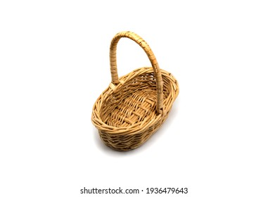 Empty wicker wooden basket on isolated white background.
