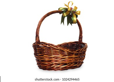 Empty wicket basket with bow isolate on white background