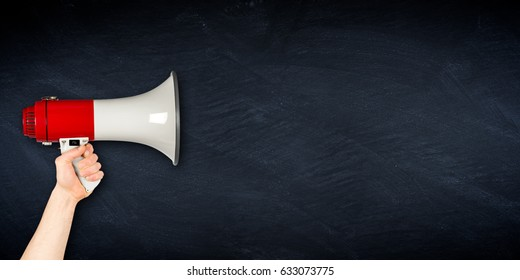 empty wide slate blackboard chalkboard with hand holding megaphone business blank background