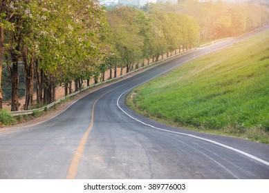 an empty winding long road
