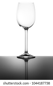 Empty Wine Glass and Reflection Isolated on White Background