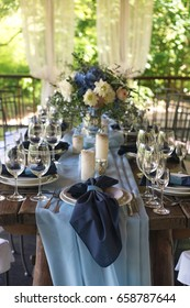 Empty wine glasses on the background of the decorated table. Wedding subjects. Registration Wedding dinner.