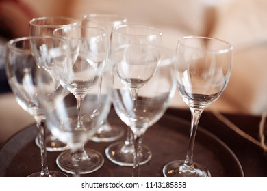 Empty wine glasses on a kitchen counter.