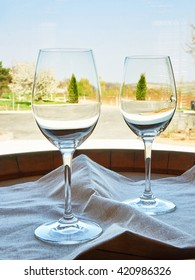Empty wine glasses on a wooden barrel