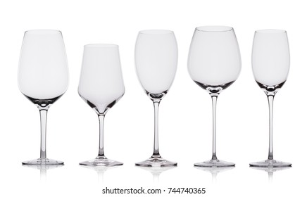 Empty wine glasses with reflection on white background with reflection