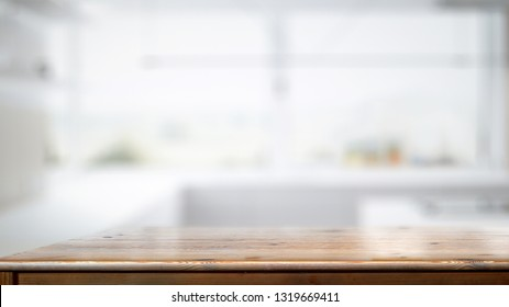 Empty wood counter table in white kitchen room background.