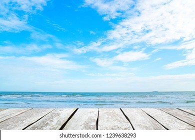 empty wood desk and summer blue sea background .Blank space for text and images.Concept Summer, Beach, Sea, Relax, Party.