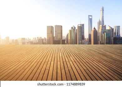 Empty wood floor with city landmark buildings background at Shanghai bund Skyline