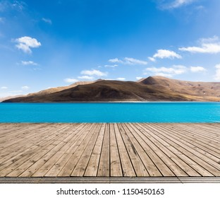 empty wood floor foreground and tibet holy lake landscape