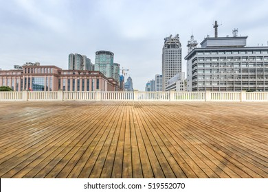 Empty wood floor with modern business office building